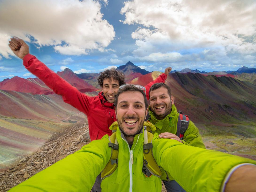 Travellers explore the Rainbow Mountains in Peru.